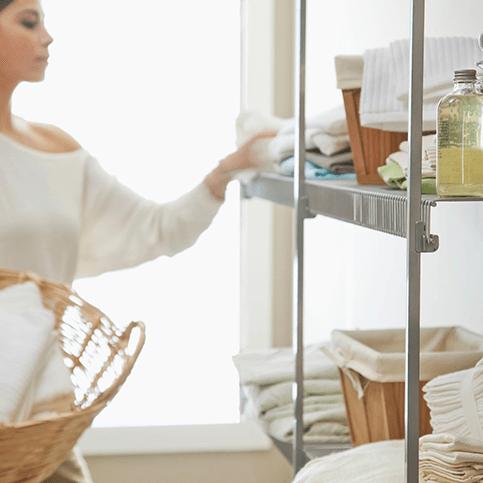 Woman organizing home in Omaha, NE