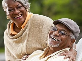 Happy elderly Black couple decluttering in Omaha, NE